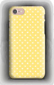 vita prickar på ett gult skal
