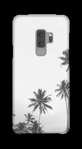 Svartvita palmer på ett skal för iPhone eller Samsung