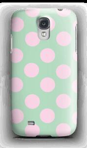 Pastellprickar med färgerna grönt och rosa på ett skal