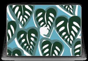 Ett tropiskt skin i de fina färgerna dusty turkos och djup grön till din laptop.